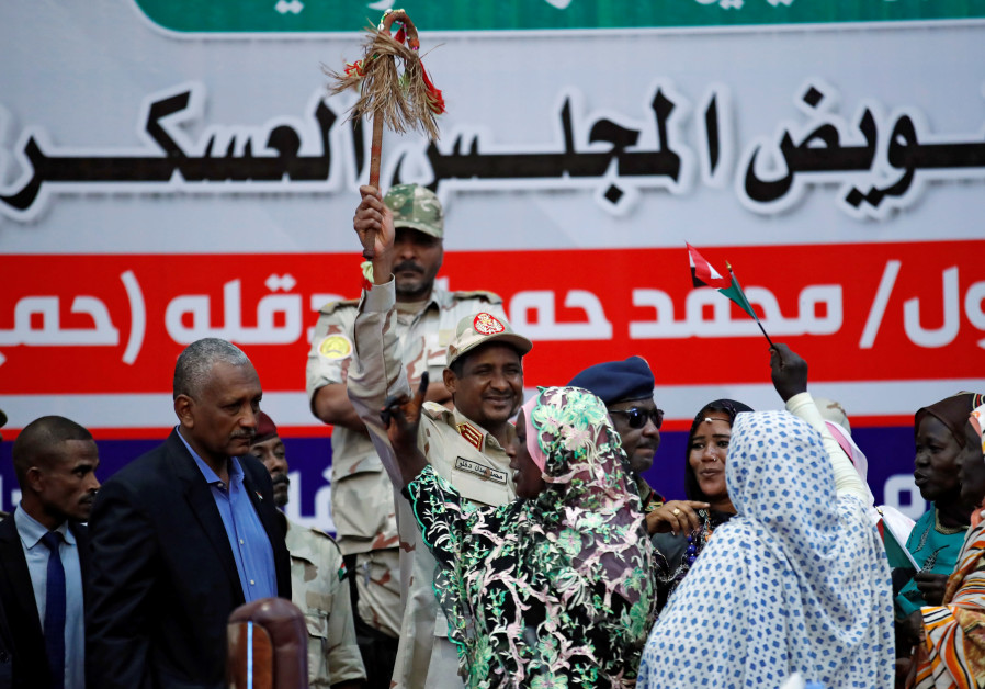 Lieutenant General Mohamed Hamdan Dagalo greets his supporters during a meeting in Khartoum, Sudan.