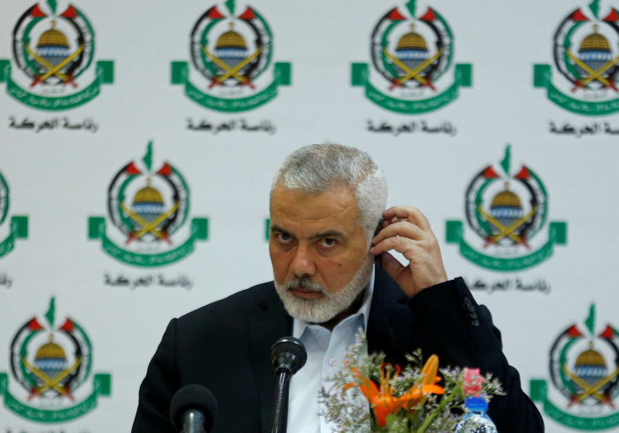 Hamas Chief Ismail Haniyeh attends a meeting with members of international media in Gazaa