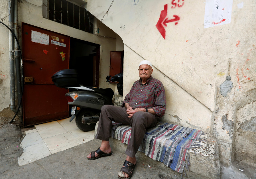 Palestinian refugee Abu Ahmad sits at Shatila refugee camp, in Beirut