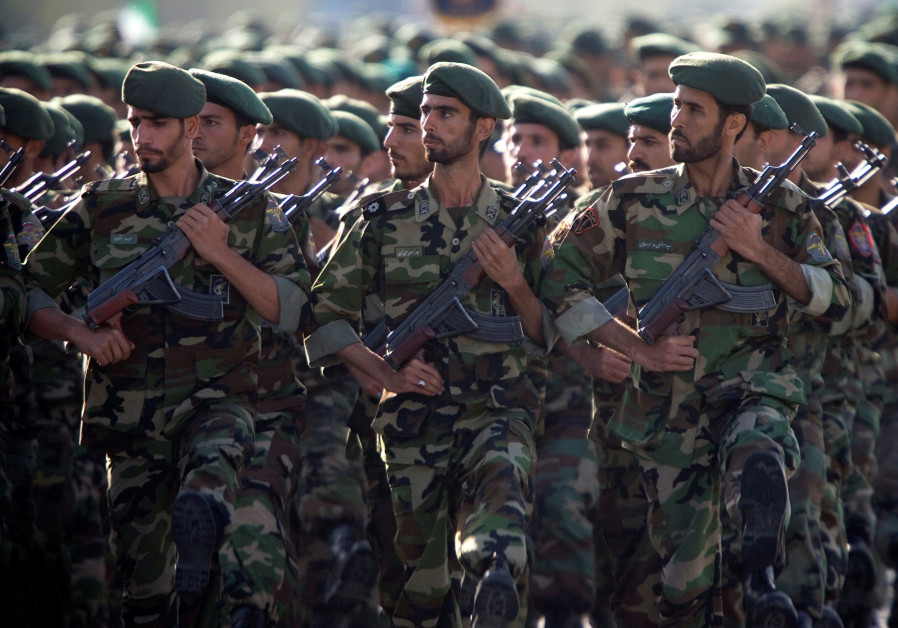 Members of Iran's Revolutionary Guards march during a military parade to commemorate the 1980-88 Ira