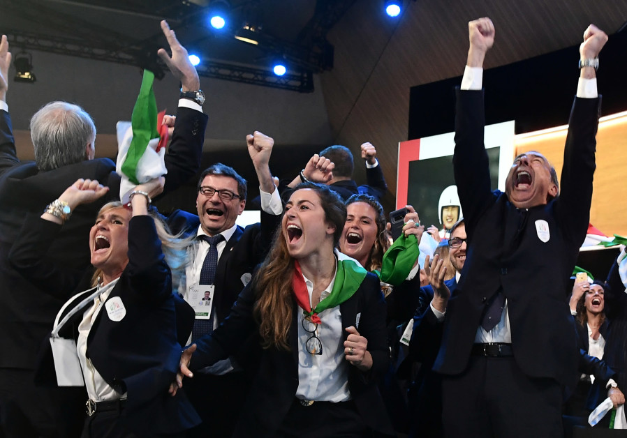 Mayor of Milan Giuseppe Sala and delegation members representing Milano and Cortina celebrate after