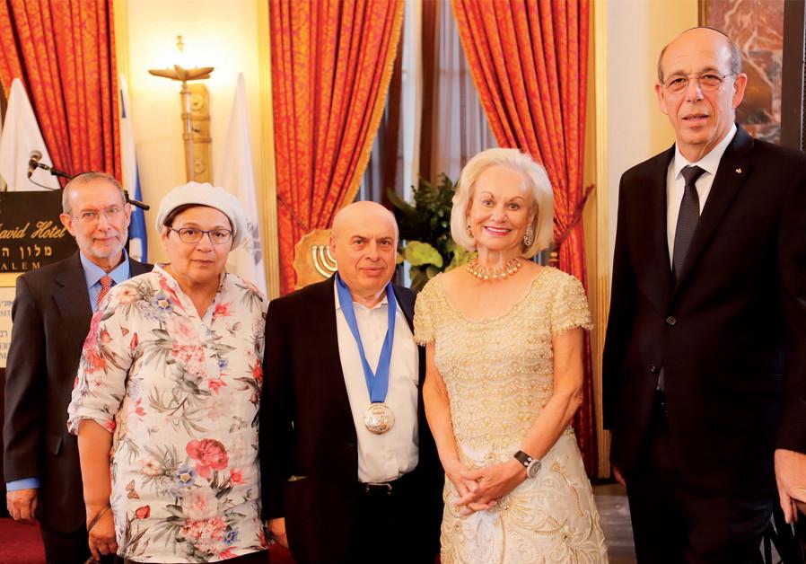 Prof. Joshua Schwartz, director of the Rennert Center, Avital and Natan Sharansky, Ingeborg Rennert, and Bar-Ilan University President Prof. Arie Zaban (Credit: YONI REIF)