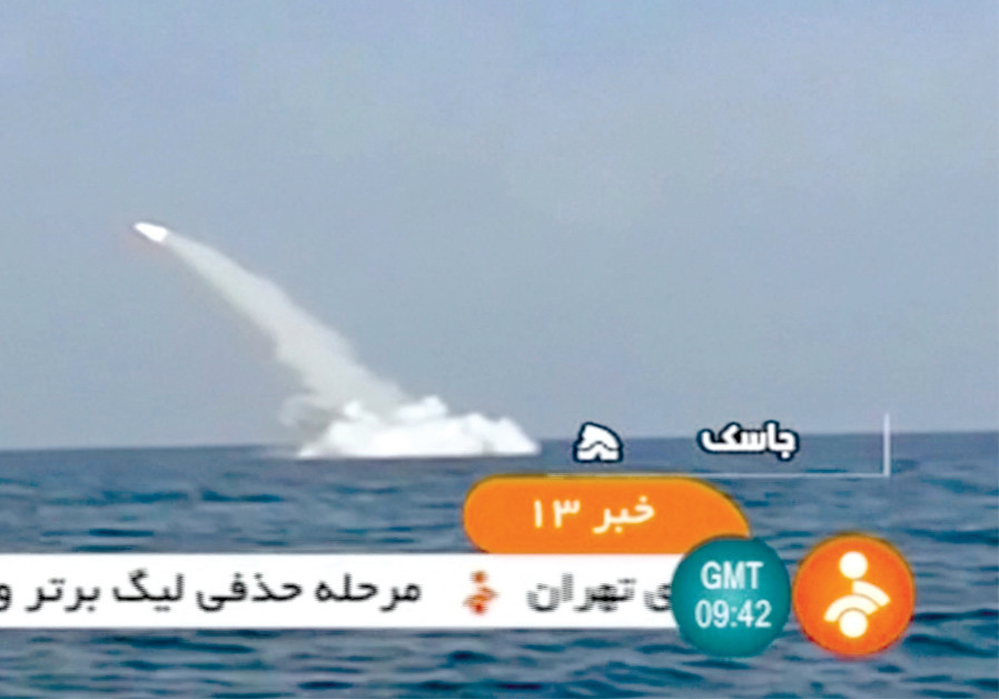 AN IRANIAN cruise missile fires into the air from a submarine during a test at Strait of Hormuz on February 24, in this still image taken from a video. (Credit: IRINN VIA REUTERS TV)