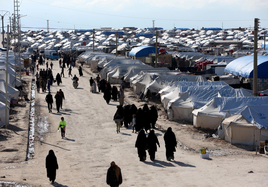 Women walk through al-Hol displacement camp in Hasaka governorate, Syria April 1, 2019