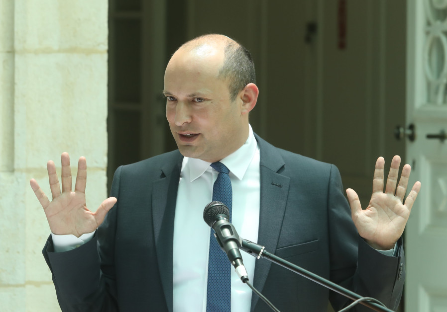 Naftali Bennett at a ceremony at the education ministry
