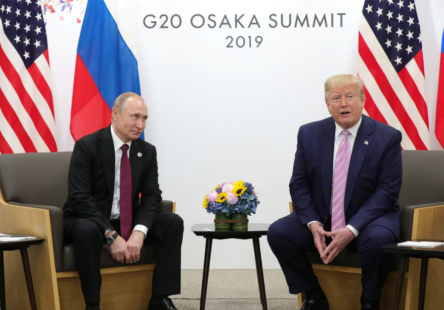 Russia's President Vladimir Putin and U.S. President Donald Trump attend a meeting on the sidelines