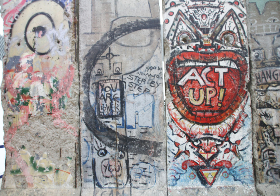 A SECTION of the Berlin Wall is displayed at the Newseum in Washington (Tovah Lazaroff)