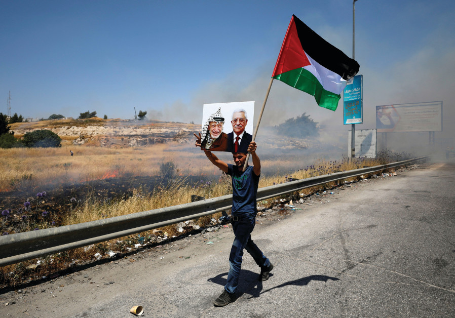A PALESTINIAN PROTESTS the Bahrain summit