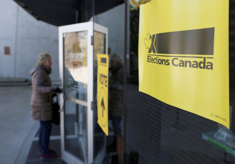 A woman enters a polling station during the Burnaby South federal by-election in Burnaby, British Co