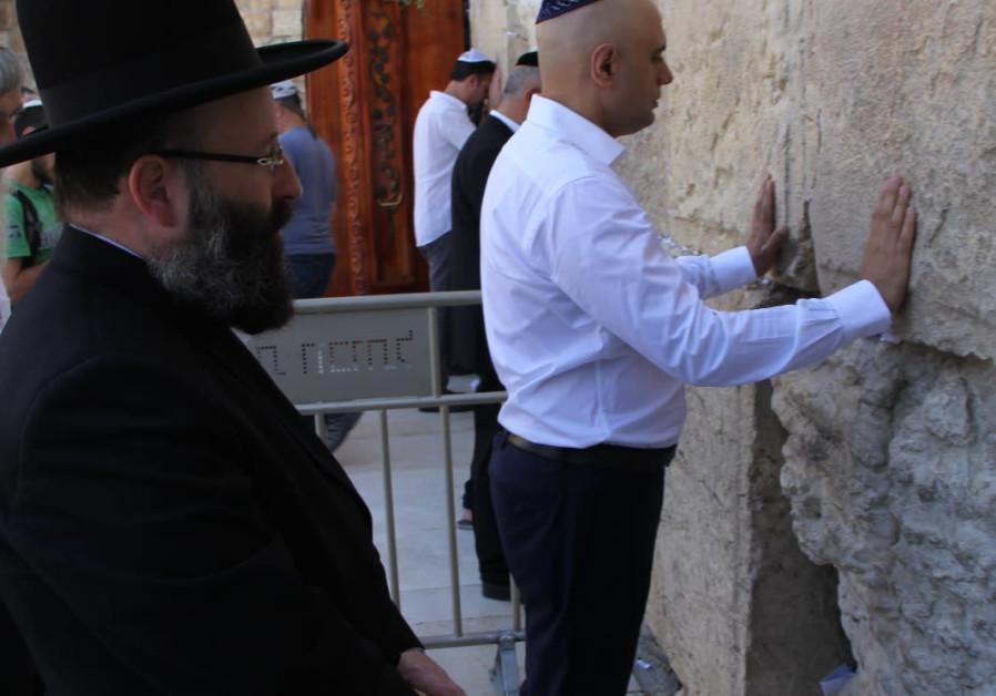 British Home Secretary Sajid Javid stands at the Western Wall alongside Chief Rabbi of the Western Wall, Rabbi Shmuel Rabinowitz, July 1 2019