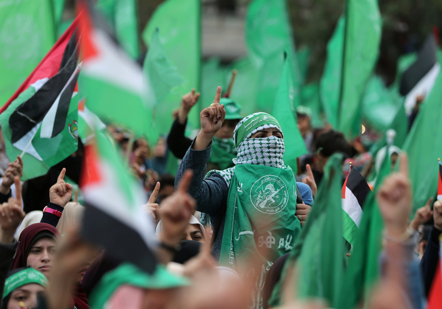 Palestinians take part in a rally marking the 31st anniversary of Hamas' founding, in Gaza City