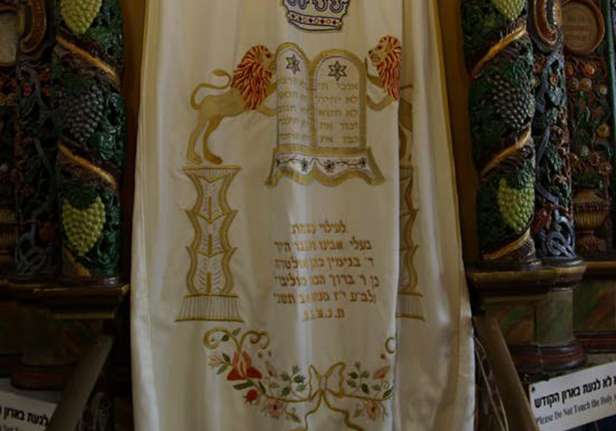 ARK IN the Ari Ashkenazi synagogue in Safed. The Ari – Isaac Luria, author of 'The Gate of Reincarnations' –is symbolized by the lion (CREDIT: Wikimedia Commons)