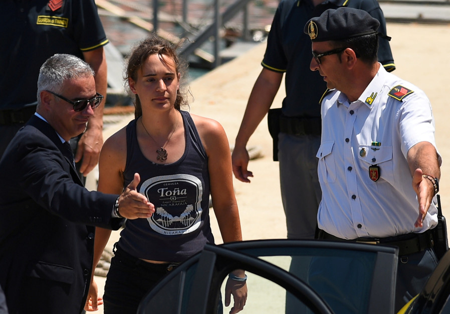 Carola Rackete, the 31-year-old Sea-Watch 3 captain, disembarks from a Finance police boat and is es
