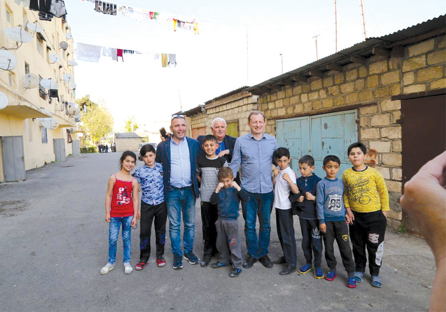MEETING WITH children of Azerbaijan's Tartar region, who suffer from regular Armenian fire. (Credit: Courtesy)