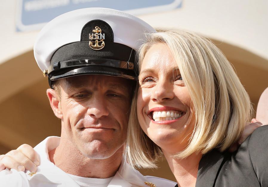 U.S. Navy SEAL demoted for posing with dead prisoner