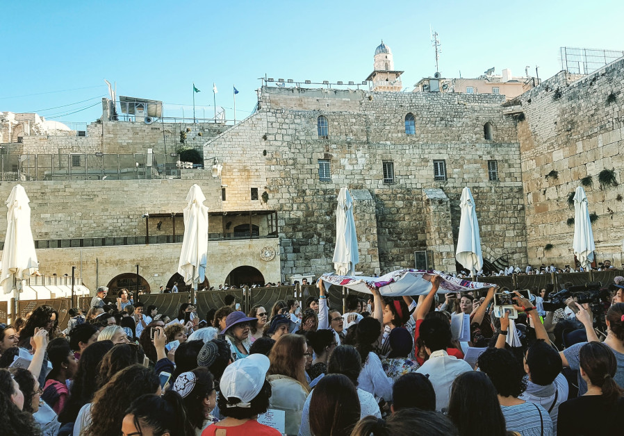 Despite heckling, Women of the Wall finish prayers at Kotel's women's section