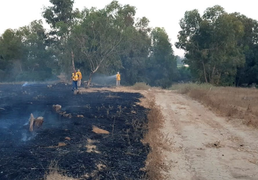 KKL-JNF firefighters extinguish a fire in Kissufim Forest near the Gaza Border. Note that the road a