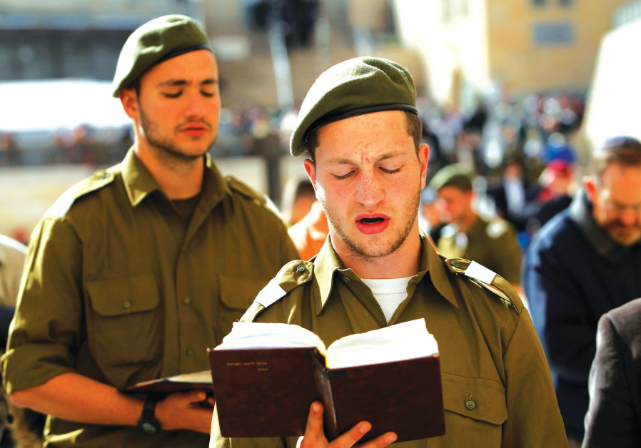 RELIGIOUS IDF soldiers pray at the Western Wall.