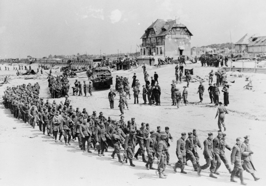 German POWs marching along Juno Beach landing area at Bernieres Sur Mer