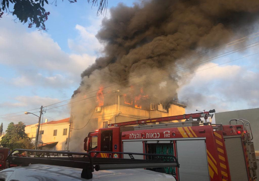 The house of Carmel Mauda burning