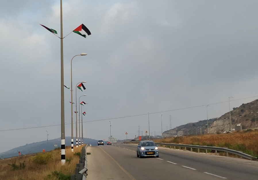 Palestinian flags hung by the roads across the West Bank