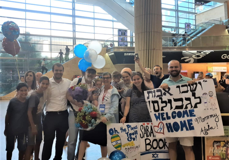 Members of the White family greet Beth and Paul White at Ben Gurion airport Thursday morning
