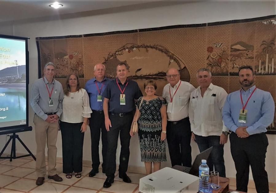 Dr. Doron Markel [L] with KKL-JNF conference delegates and leaders of the Cuban Jewish community, Ju