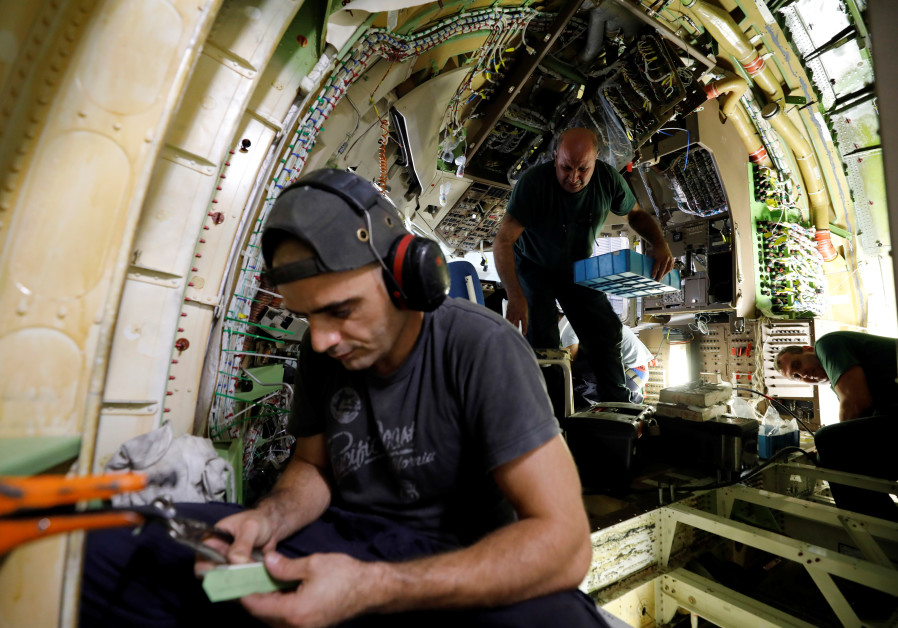 IAI workers convert Boeing 767 plane from passenger to cargo use for Amazon