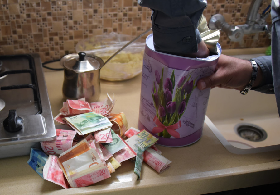 Police seized over one million shekels during the raid in Maghar, Israel
