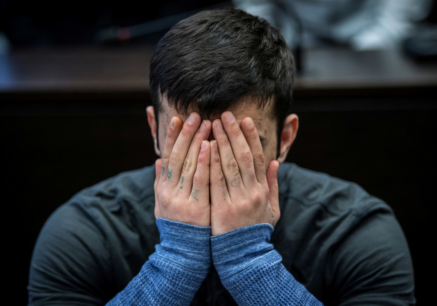 Ali Bashar covers his face during his trial for the murder and rape of Susanna Feldmann, March 2019.