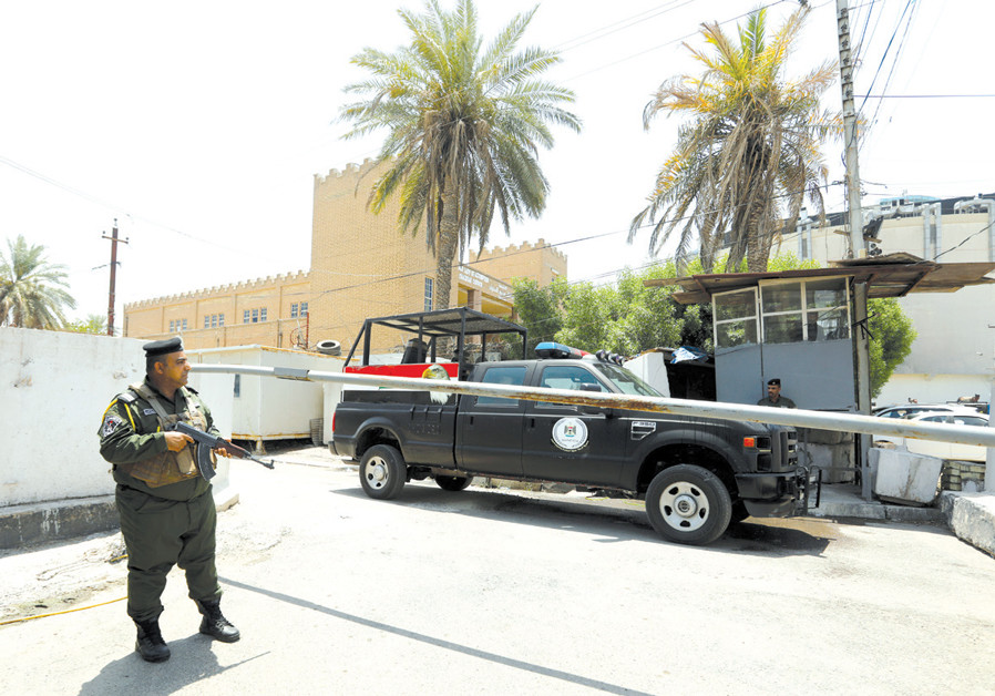 IRAQI SECURITY forces stand guard outside the Bahraini embassy in Baghdad on June 28. (Credit: THAIER AL-SUDANI/REUTERS)