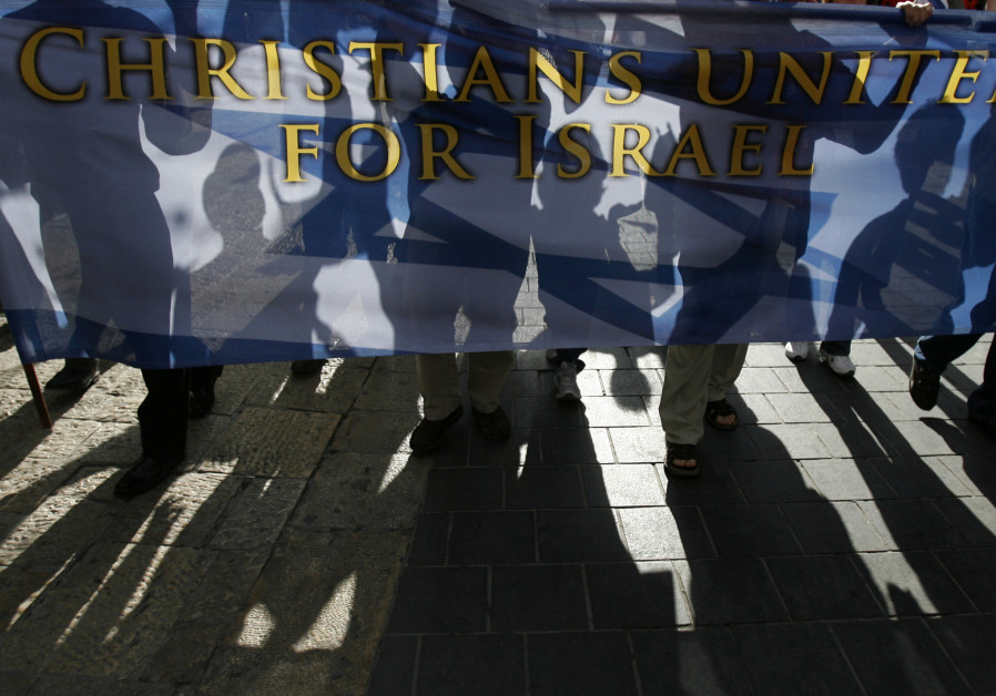 Christian demonstrators carry a banner during a march in Jerusalem