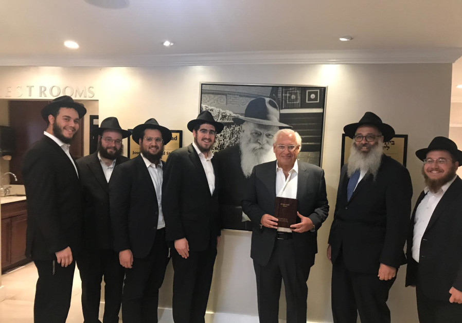 US Ambassdor to Israel, David Friedman (Center), receives his new copy of the Tanya from Rabbi Wolow