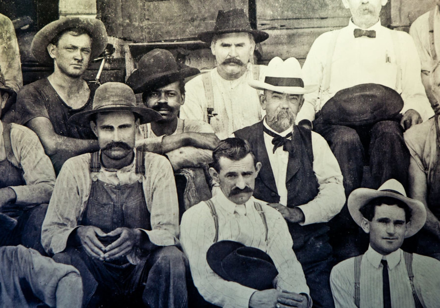 Nearest Green's son, George Green, seated next to Jack Daniel.