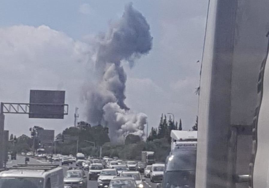 Smoke rising from an explosion at a military warehouse in Herzliya