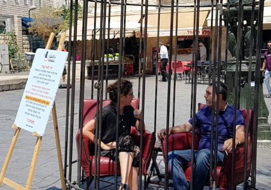 Cage in Haifa highlights the struggle of women trapped in divorce