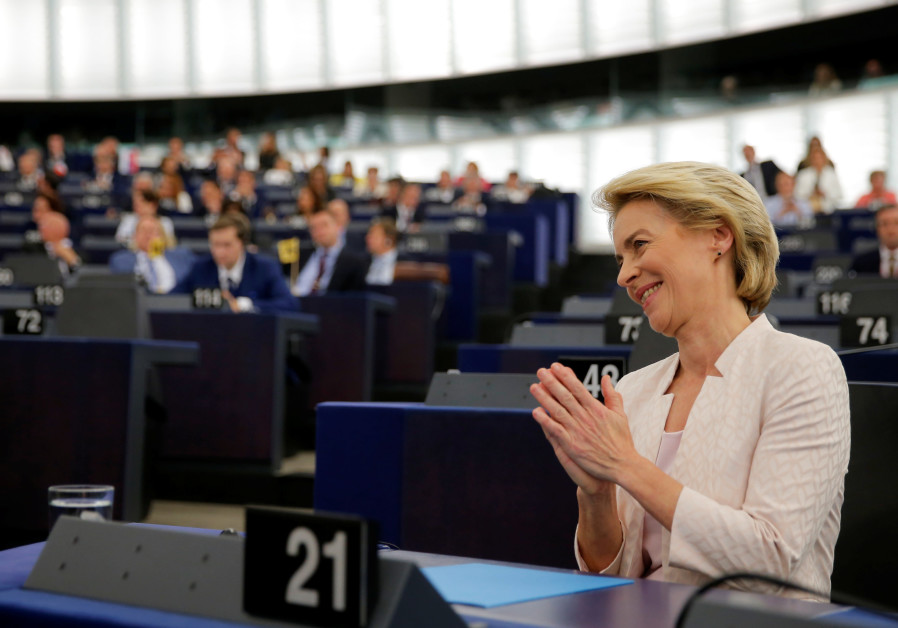 Elected European Commission President Ursula von der Leyen reacts after a vote on her election at th