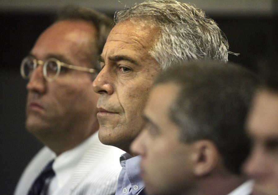 U.S. financier Jeffrey Epstein (C) appears in court where he pleaded guilty to two prostitution char