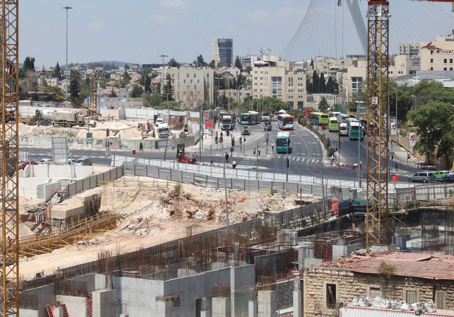 HAVING JERUSALEM Gateway work vehicles and assorted construction materials taking up a large part of the Jerusalem International Convention Center parking lot doesn't exactly help the situation. (Credit: MARC ISRAEL SELLEM)