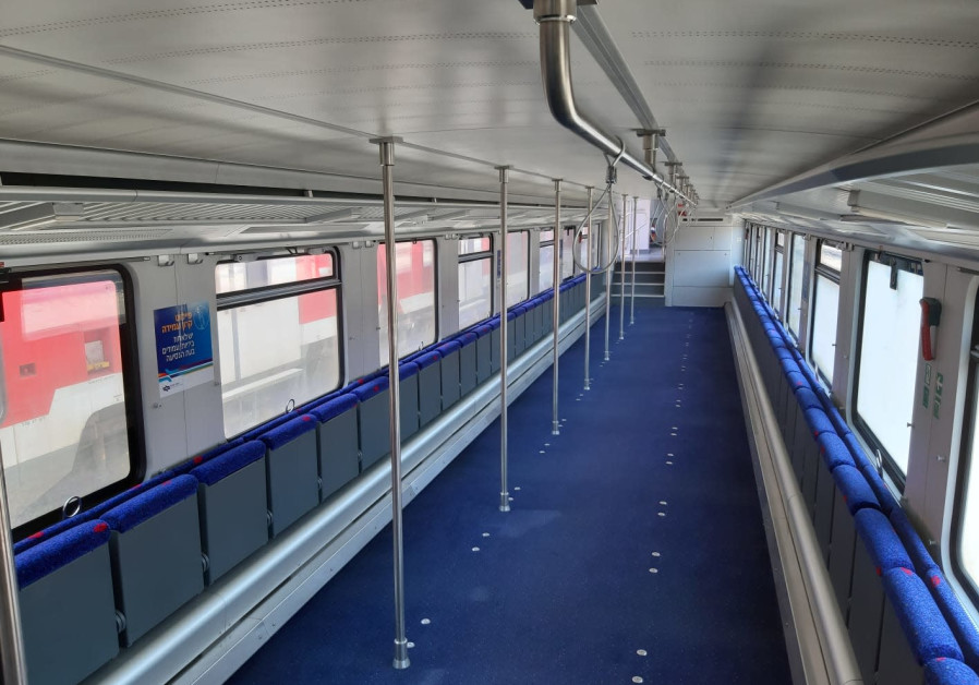 A converted Israel Railways carriage enabling standing-only travel at rush hour