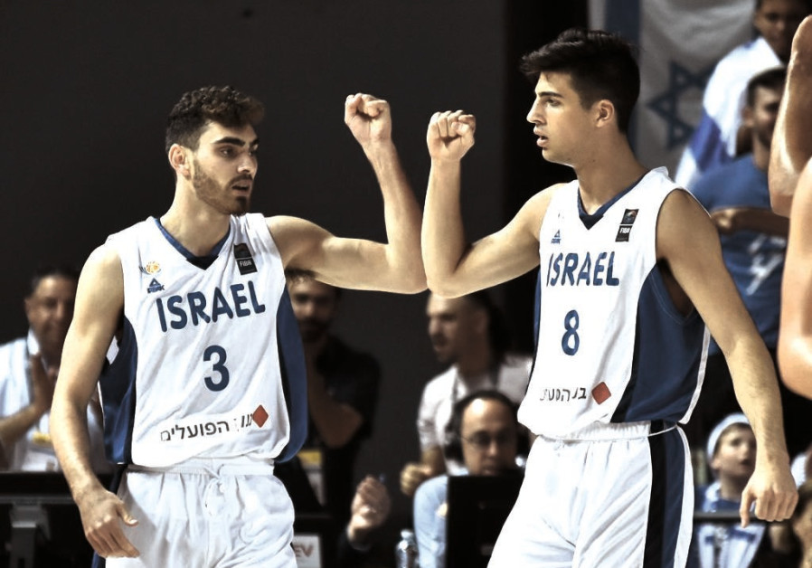 Yair Kravits (3) and Deni Avdija celebrate during last night's victory over Montenegro.