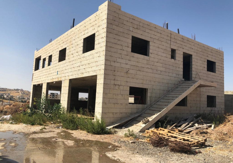 Palestinians home razings near security barrier may be delayed