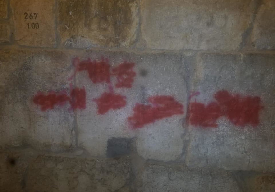 "Spray paint on the Little Western Wall, now covered, read ""Slaughter the Jews"""