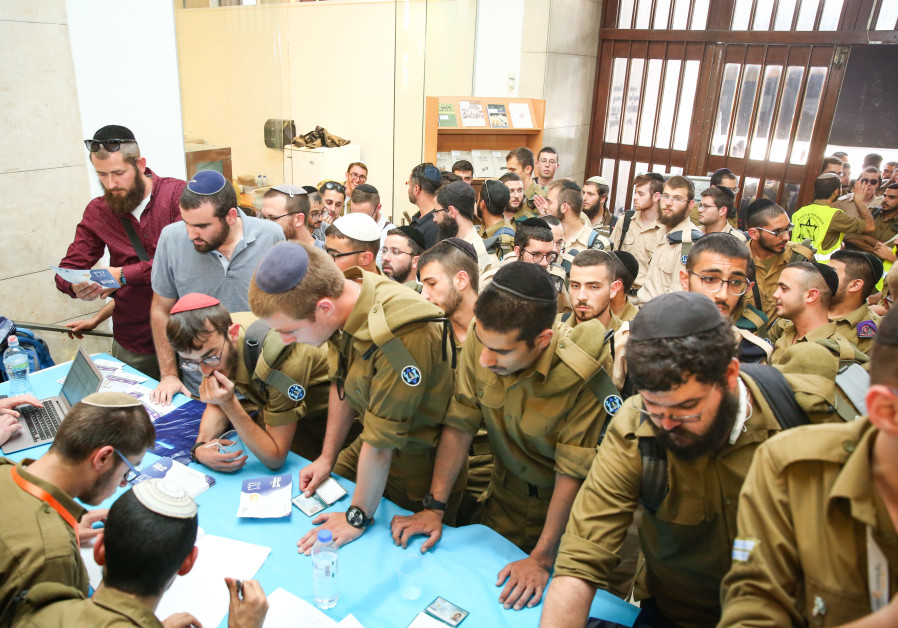 "Hundreds of Haredi IDF veterans took part in the ""Profession for a Lifetime"" academic studies and employment fair in Jerusalem (Credit: Itzik Belnitsky/Ministry of Defense)"