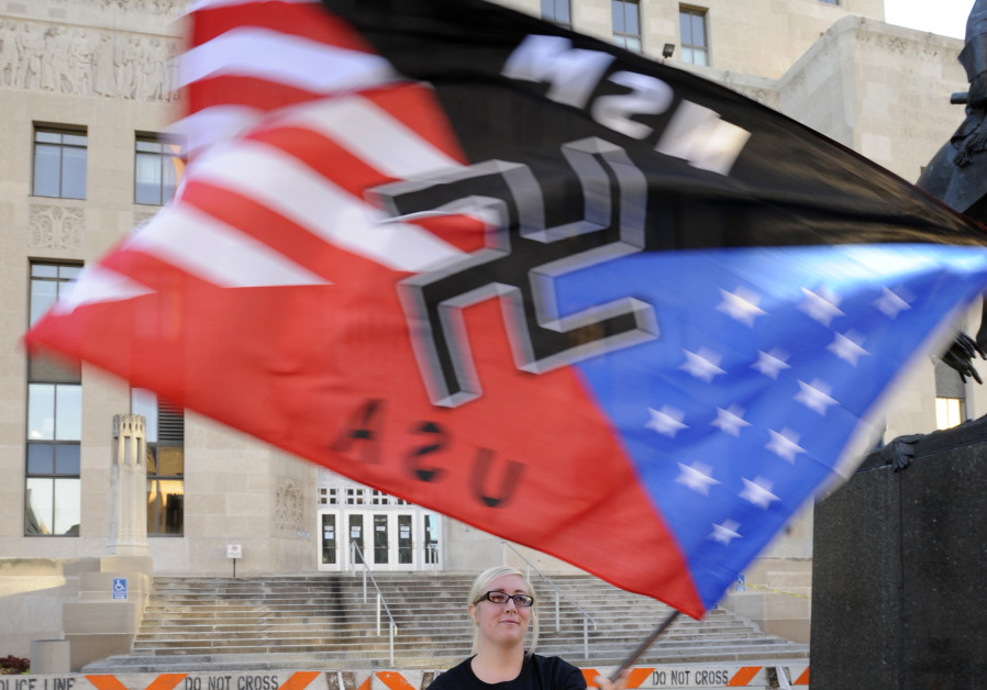 A supporter waves her flag during a neo-Nazi rally at the Jackson County Courthouse in Kansas City,