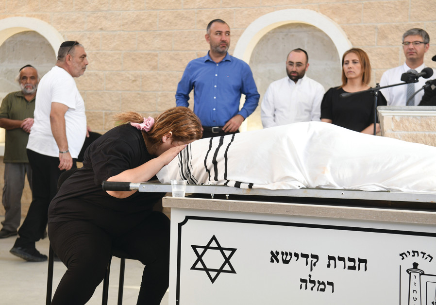 DIKLA HASDAI mourns her husband, Ofir, during his funeral at the Ramle Cemetery yesterday.