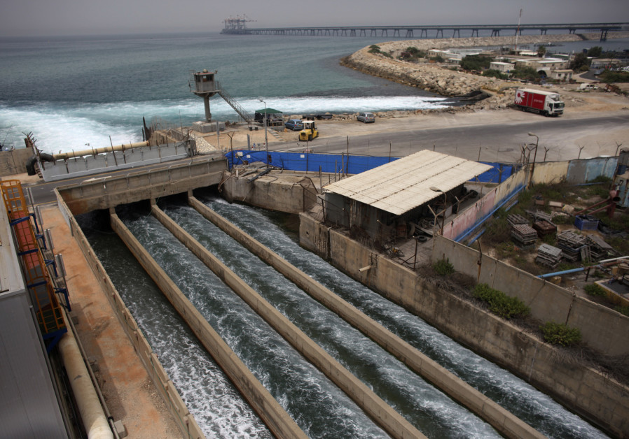 Brine water flows into the Mediterranean Sea after passing through a desalination plant in Hadera