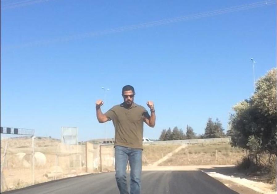 Israeli diplomat Ishmael Khaldi walks on the access road to the Bedouin village of Khawaled (Courtesy)