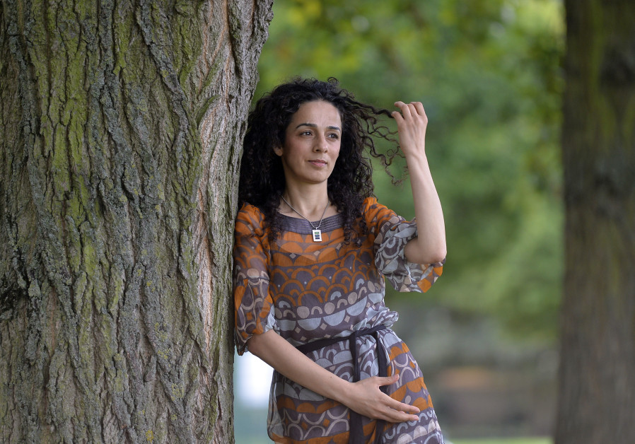 Iranian dissident Alinejad poses for a portrait in London in 2013.