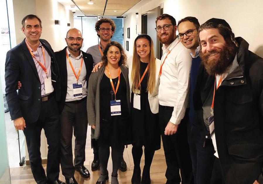 MENTORING ENTREPRENEURS at Bizmax, a Jerusalem-based innovation center for haredi men. (Credit: Courtesy)